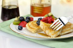 Pancake on a plate with fork Stock Image