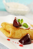 Pancake with plum Royalty Free Stock Images