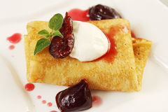 Pancake with plum jam Stock Photography
