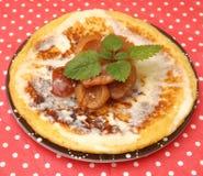 Pancake. A pancake with plums and vanilla sauce Stock Image