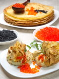 Pancake pouches with red and black caviar. Stock Images