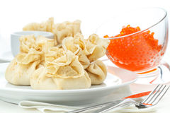 Pancake pouches with red caviar Royalty Free Stock Photography