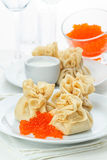 Pancake pouches with red caviar Stock Photo