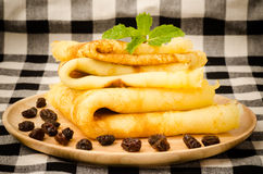 Pancake. With raisin on wooden plate Royalty Free Stock Photography