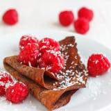 Pancake with Raspberries. Healthy eating. Delicious Chocolate Pancakes with raspberries and coconut Stock Image