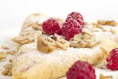 Pancake with raspberries and nuts. Pancakes crepes with raspberries - healthy breakfas Stock Images