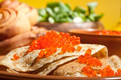 Pancake with red caviar Stock Photos