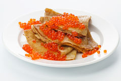 Pancake with red caviar Royalty Free Stock Photo