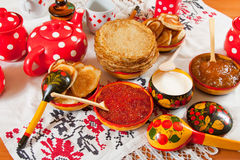 Pancake with red caviar. And tea during Shrovetide stock image