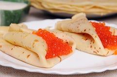Pancake with red caviar Royalty Free Stock Photos