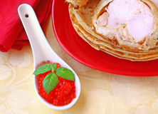 Pancake with red caviar Stock Photos