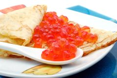 Pancake with red caviar Stock Image