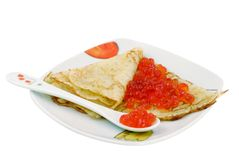 Pancake with a red caviar Stock Images
