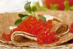 Pancake with red caviar Royalty Free Stock Image