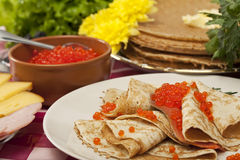 Pancake with red caviar Stock Photo