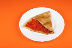 Pancake with red caviar Royalty Free Stock Photography