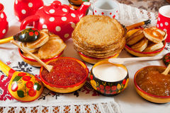 Pancake with red caviar. And tea during  Pancake Week Stock Image