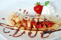 Pancake with rhubarb and apple. Whipped cream, strawberries, almonds and chocolate Royalty Free Stock Images