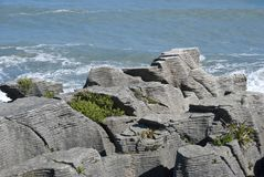 Layered rock formation. Pancake rock New Zealand, coastline of south island Royalty Free Stock Photos