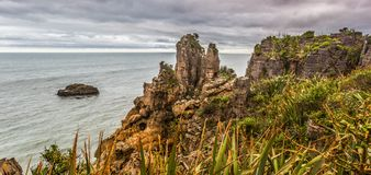 Pancake Rock Outcropping. View West At Tasman Sea With Pancake Rocks Outcropping, Paparoa National Park, South Island, New Zealand Royalty Free Stock Image