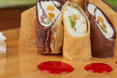 Pancake roll with marmalade Stock Images