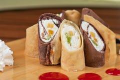 Pancake roll with marmalade Stock Photos