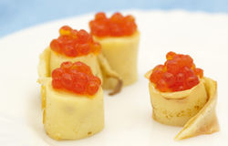 Pancake rolls with red caviar Royalty Free Stock Images