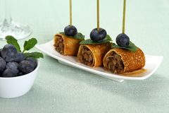 Pancake roll stuffed with minced meat as snack Stock Photo