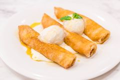 Pancake roll with vanilla ice-cream. In cafe Stock Images