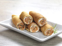 Pancake rolls. Filled with feta cream cheese,smoked fish and herbs royalty free stock photography