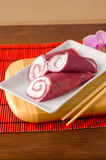 Pancake rolls with butter cream and with beets Royalty Free Stock Photo