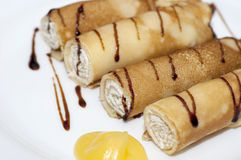 Pancake rolls with sweet cottage cheese Stock Image