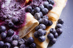 Pancake rolls with white cheese, blueberries and powdered white  sugar Stock Images