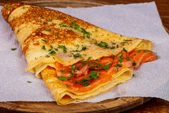 Pancake with salmon. And parsley royalty free stock photos