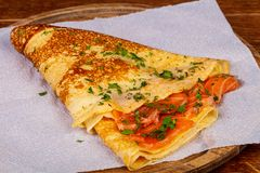 Pancake with salmon. And parsley stock photo