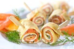 Pancake and salmon rolls royalty free stock image