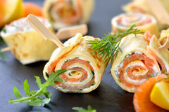 Pancake and salmon rolls royalty free stock photography