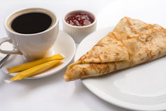 Pancake served with cup of black coffee and jam Royalty Free Stock Images