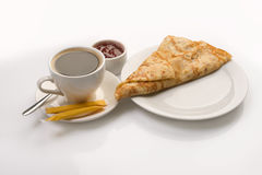 Pancake served with full cup of coffee and jam Stock Images