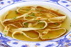 Pancake soup in blue plate, soft focus Royalty Free Stock Photos