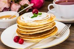 Pancake with sour cream Royalty Free Stock Photos