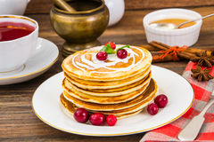 Pancake with sour cream Stock Images