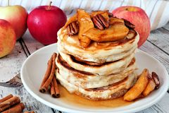 Pancake stack with apples, pecans and cinnamon and maple syrup Royalty Free Stock Photo