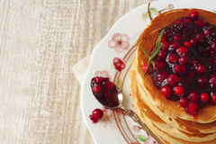 Pancake stack with lingonberry jam Stock Photography