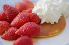 Pancake with strawberries and cream royalty free stock photo
