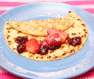 Pancake. A pancake with strawberries and jam Stock Photography