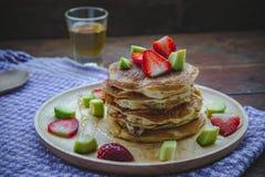 Pancake strawberry avocado fruit and honey syrup sweet dessert on wood table pan cake dessert homemade stock photos