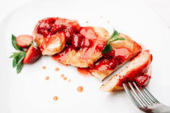 Pancake strawberry dessert with fork on white,void Stock Photography