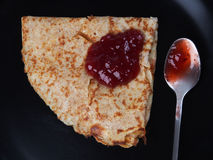 Pancake with strawberry jam Stock Photos