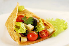 Pancake stuffed with salad Stock Images